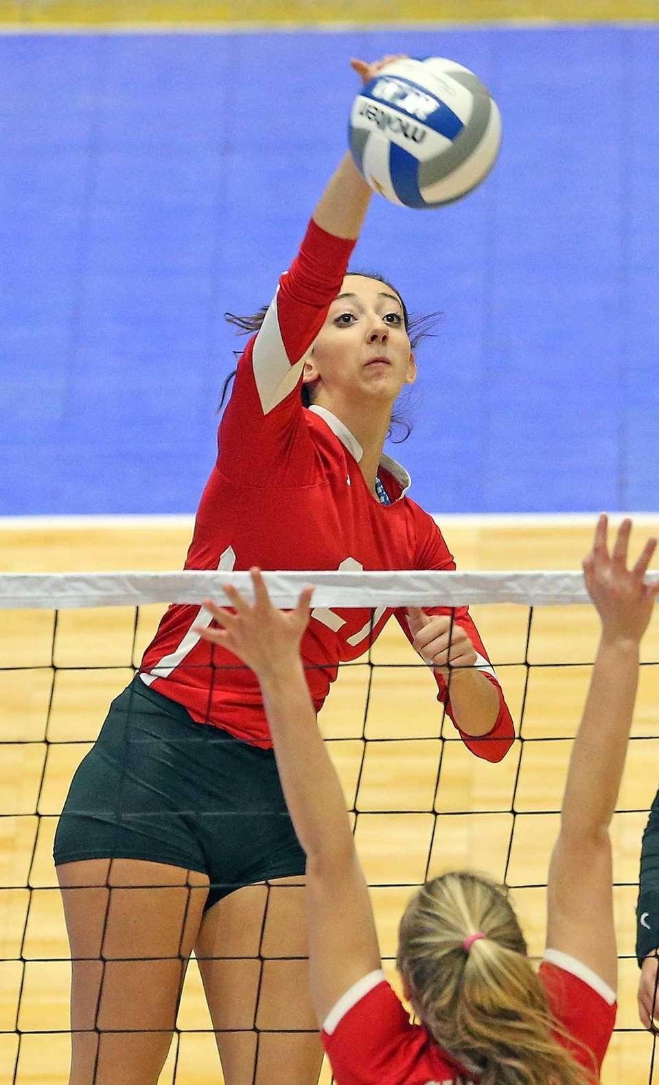 Connetquot's Cassandra Patsos smashes the overhead during the
