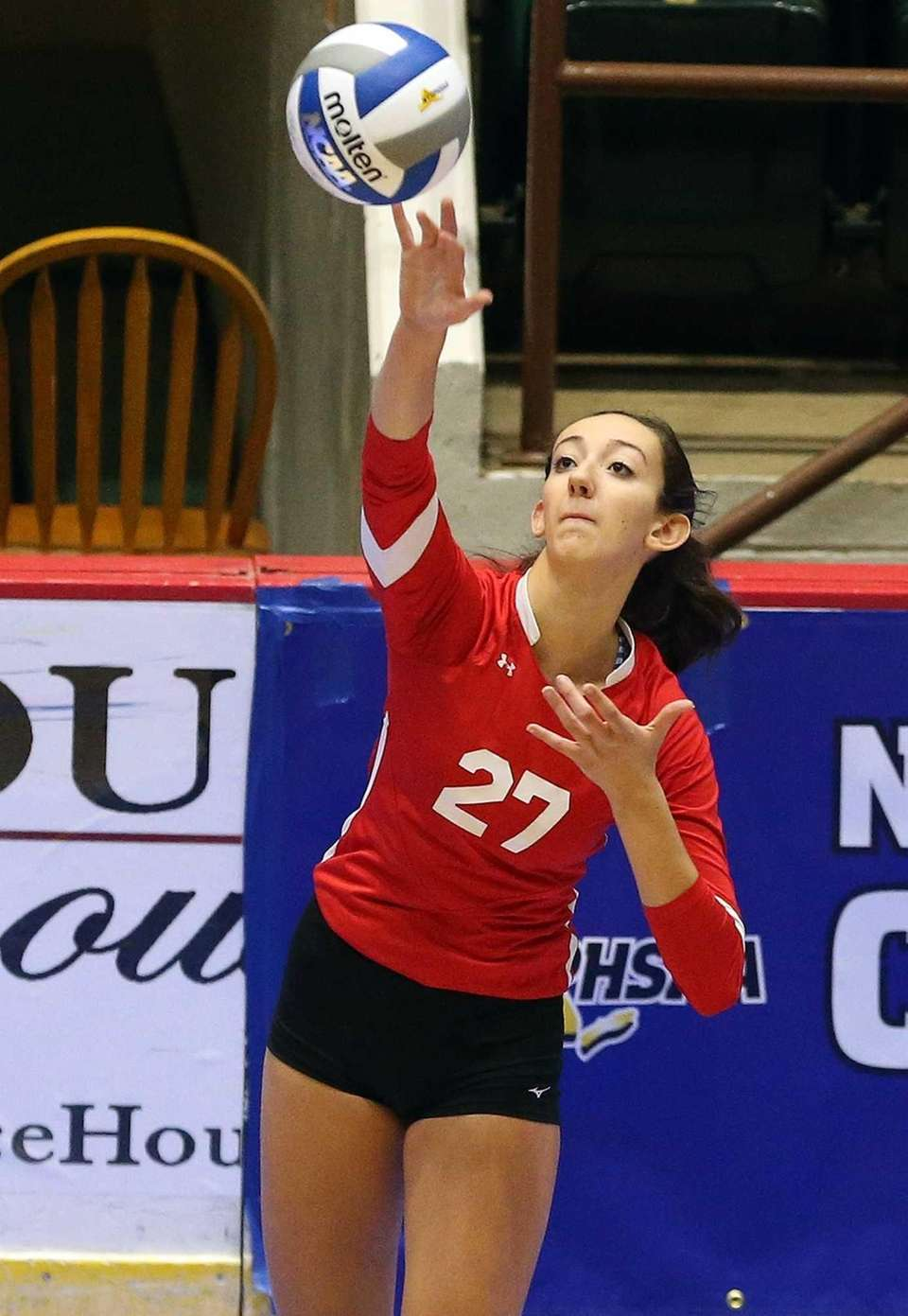 Connetquot's Cassandra Patsos with the serve during the