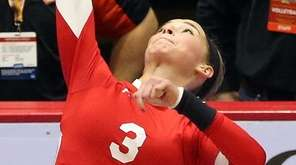 Connetquot's Taylor Cole serves the ball during the