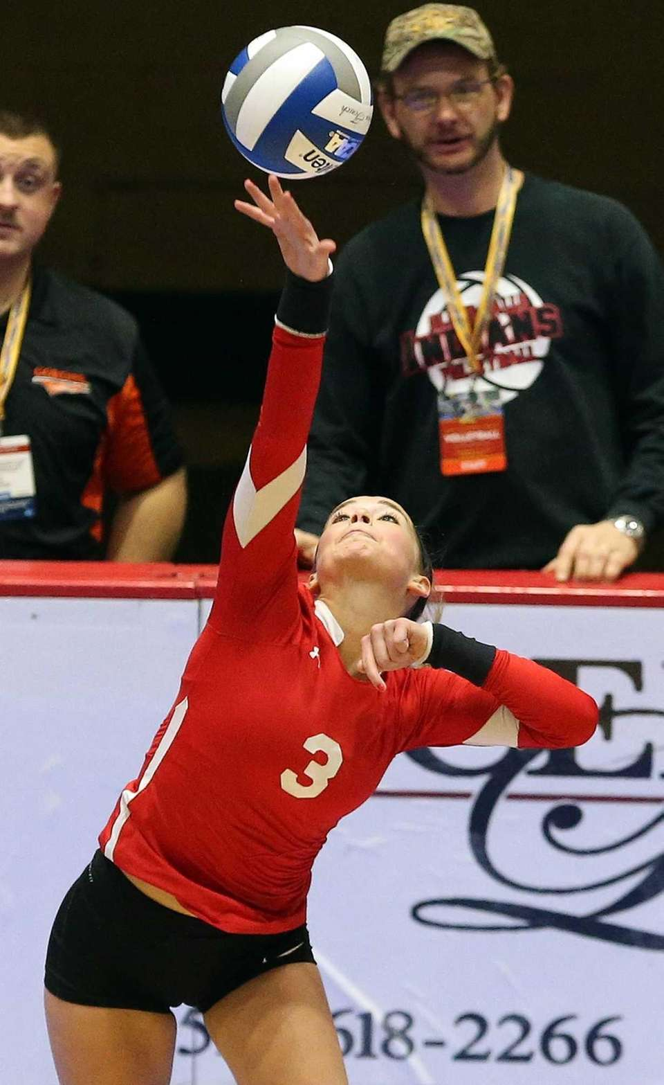 Connetquot's Taylor Cole with the serve during the