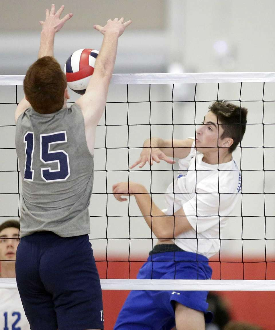 Hauppauge's Adam Gorgone (14) spikes the ball for
