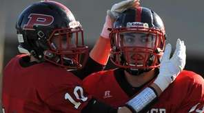 Plainedge quarterback No. 14 Davien Kuinlan, right, gets