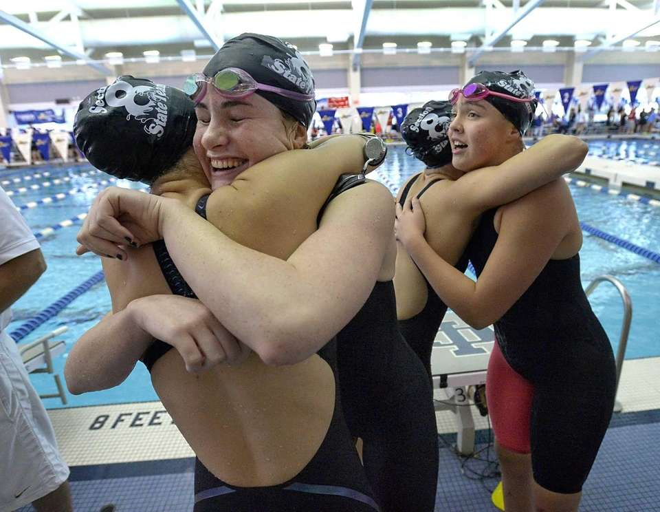 Long Beach's 400 yard medley relay team celebrates