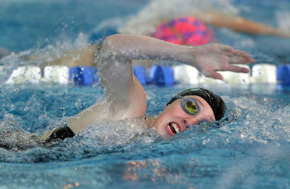 Port Washington's Annabelle Corcoran swims in the finals