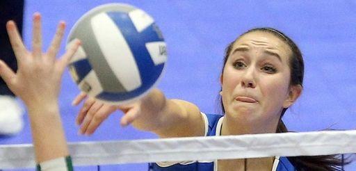 Glenn's Grace Cergol spikes the ball during girls
