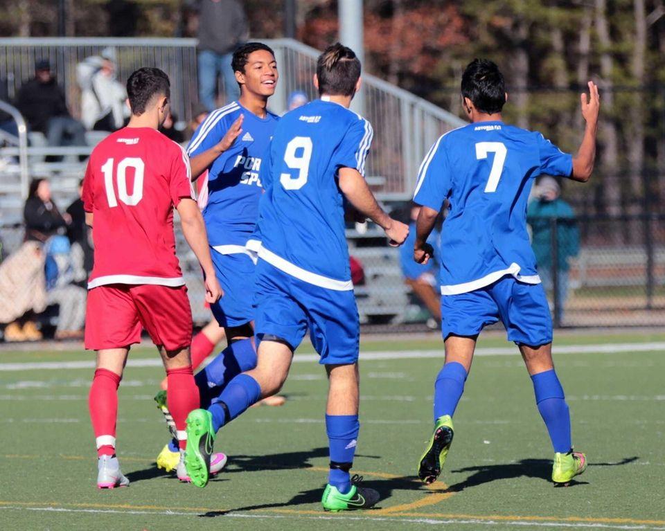 Carlos Rivera #7 (blue) is congratulated by teammates