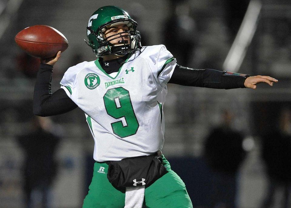 Farmingdale quarterback No. 9 Anthony Burriesci throws a