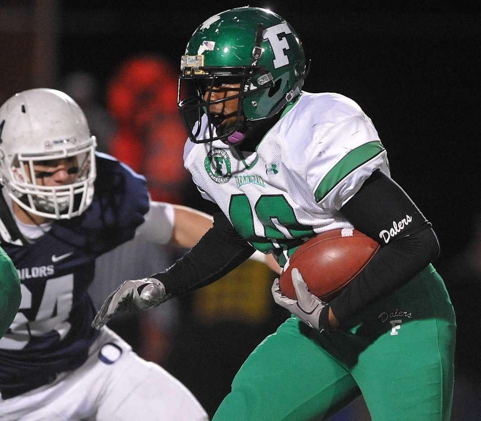 Farmingdale running back Kevin Eversley carries the ball