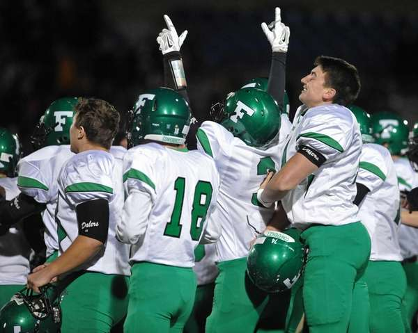 Farmingdale celebrates it 34-23 win over Oceanside in