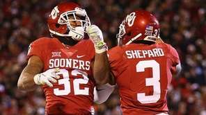 Samaje Perine #32 and Sterling Shepard #3 of