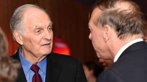 Actor, author and activist Alan Alda, left, attends