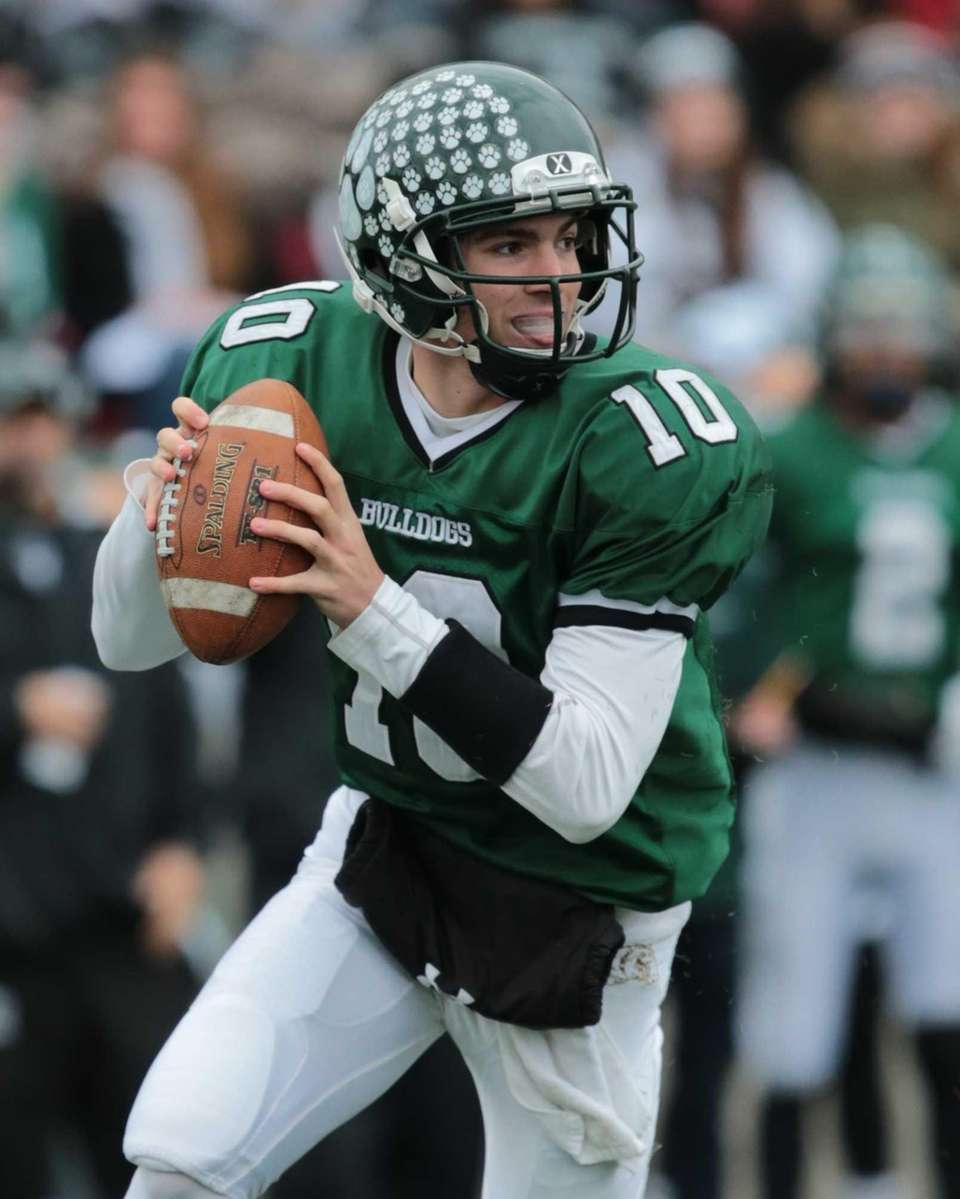 Lindenhurst quarterback Ryan Hoffmann #10 drops back to