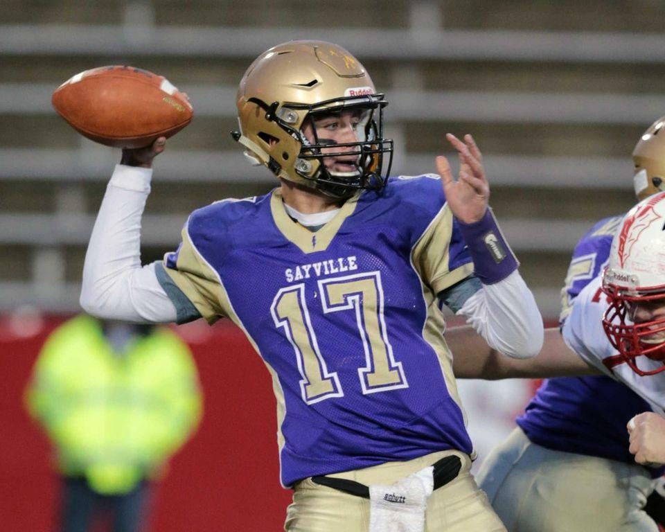 Sayville quarterback Jack Coan #17 completes a pass