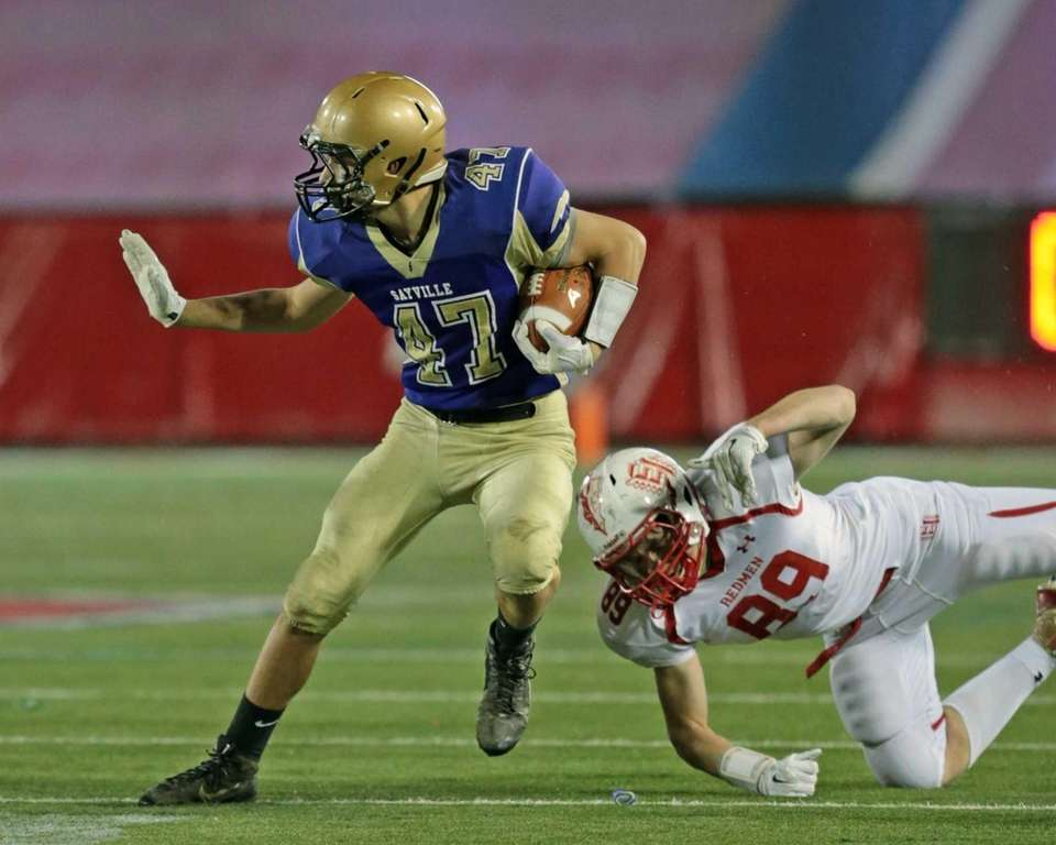 Sayville's Michael Dionisio #47 breaks a tackle and