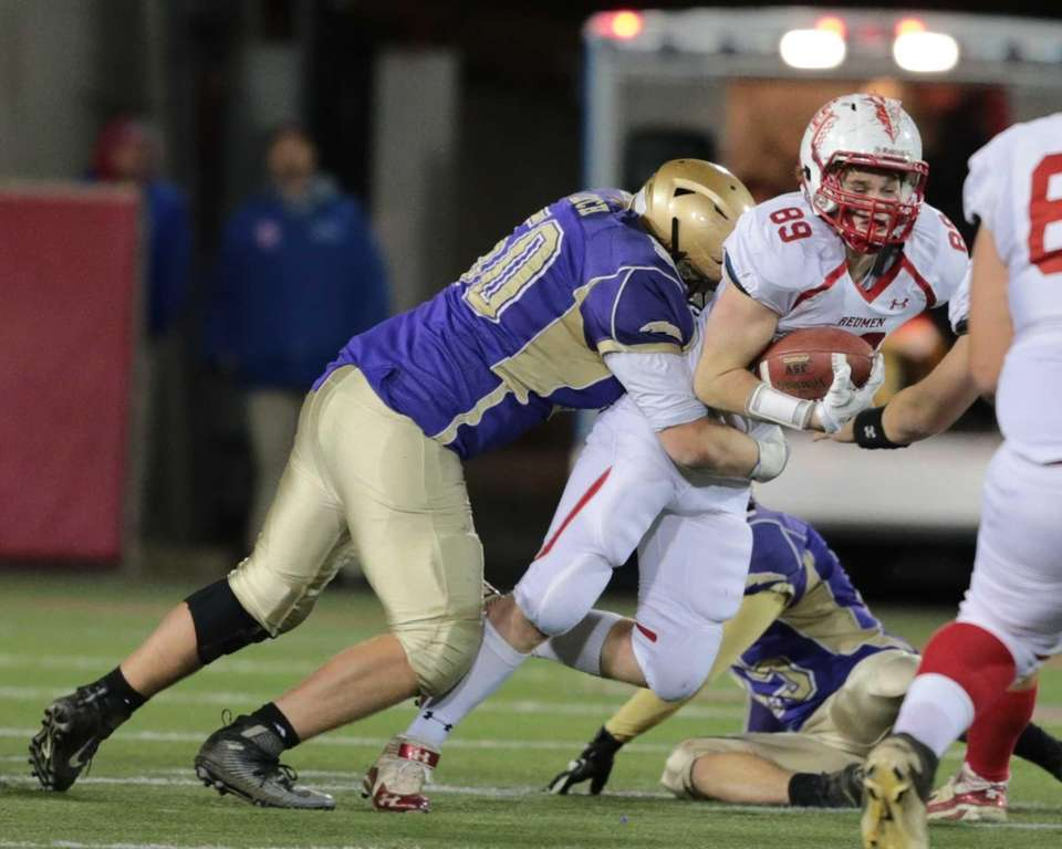 Sayville's Mike Leach #50 takes down East Islip's