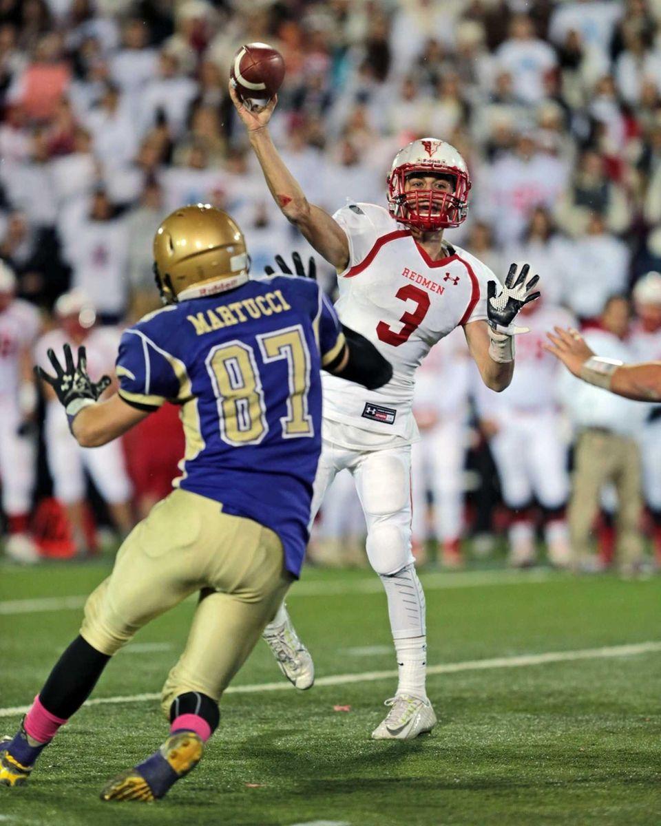 East Islip quarterback Kyle Fleitman #3 passes under