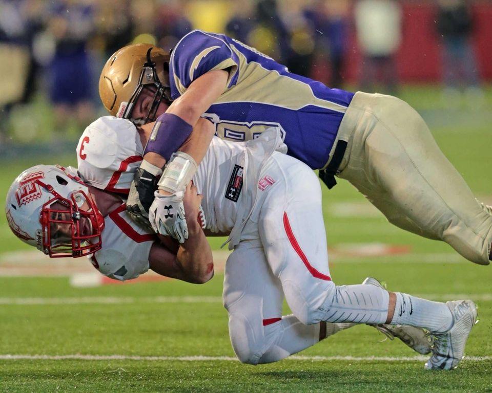 East Islip quarterback Kyle Fleitman #3 is taken