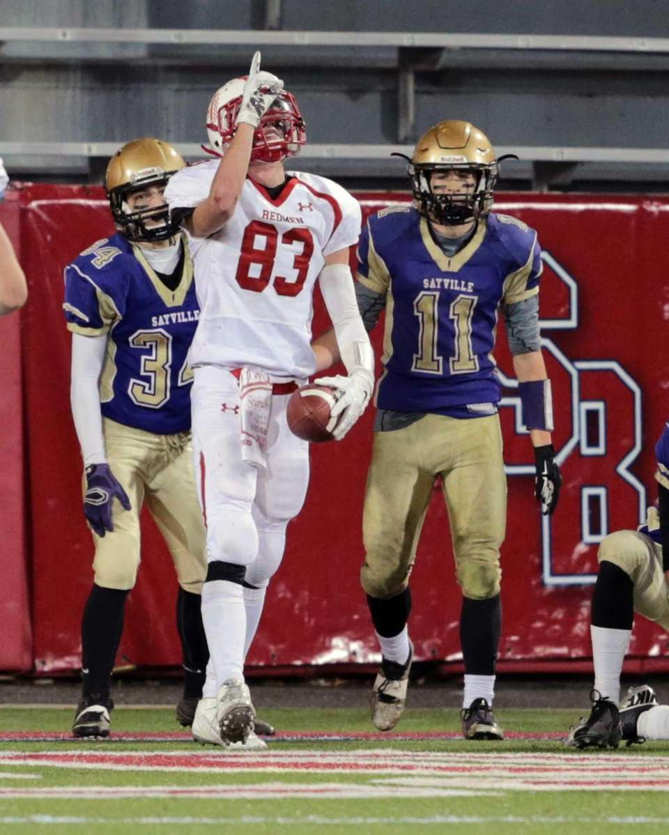 East Islip's John Sihpol #83 celebrates after catching