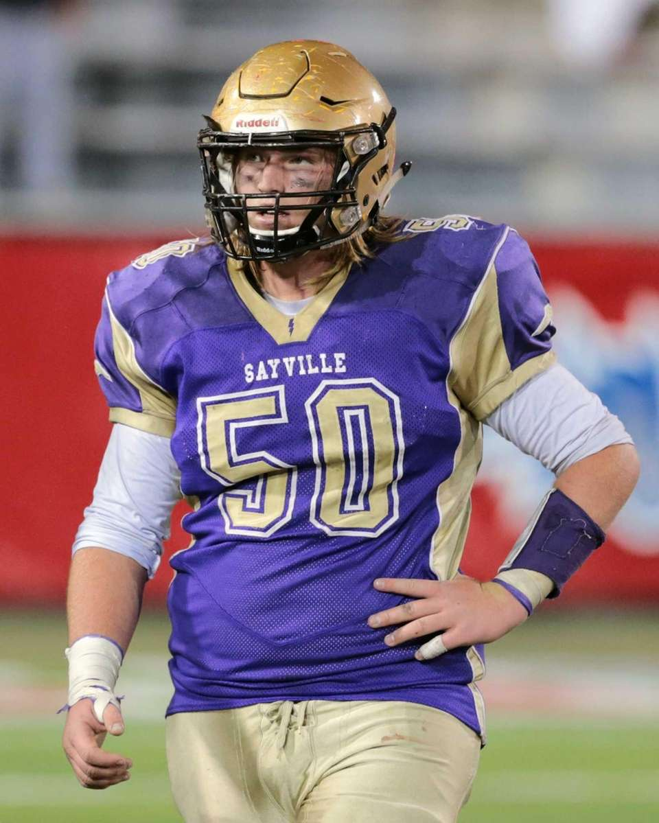 Sayville's Mike Leach #50 comes off of the