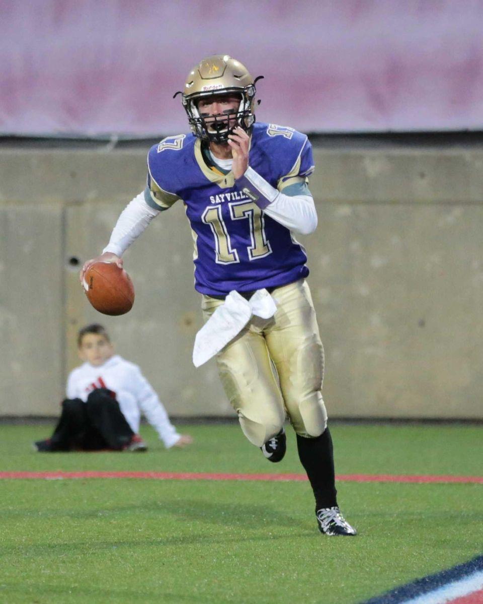 Sayville quarterback Jack Coan #17 celebrates after scoring