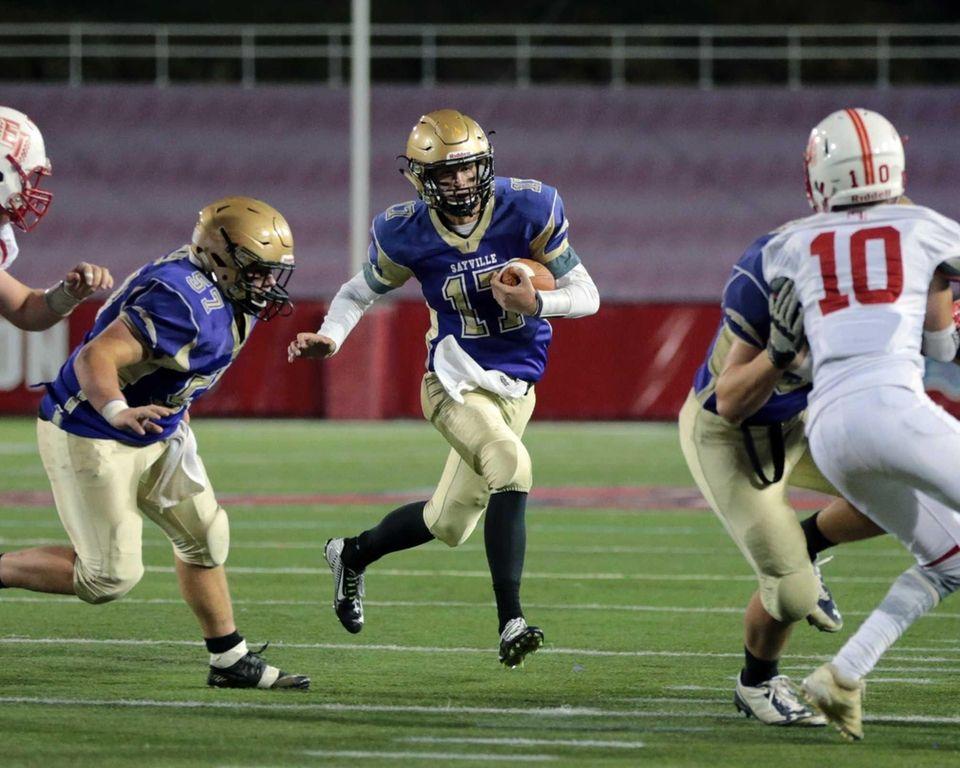 Sayville quarterback Jack Coan #17 drives toward the