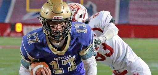 Sayville quarterback Jack Coan #17 crosses the goal