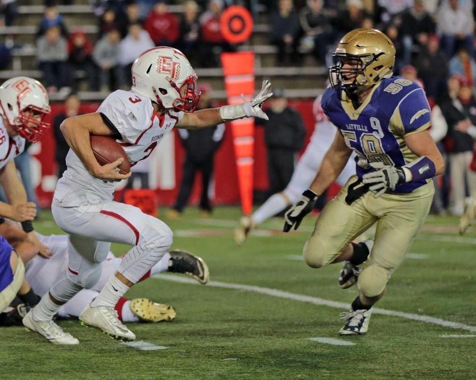 East Islip quarterback Kyle Fleitman #3 attempts to