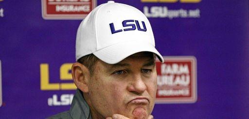 LSU head coach Les Miles ponders a reporter's