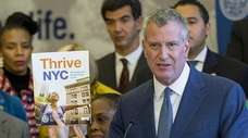 Mayor Bill de Blasio, along with the First