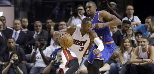 Miami Heat guard Dwyane Wade (3) drives around