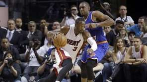 Miami Heat guard Dwyane Wade (3) drives around