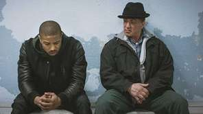 Michael B. Jordan, left, as Adonis Johnson and