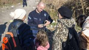 Serbian police check the identification information of Syrian