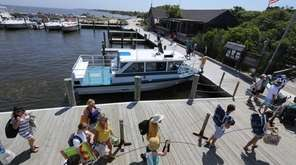 Visitors get off the ferry from Sayville at