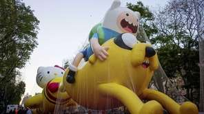 A parade balloon of Finn and Jake from