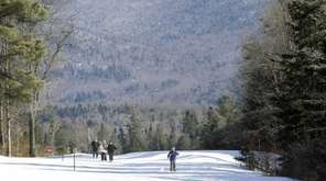 People cross-country ski in Lake Placid, N.Y. in