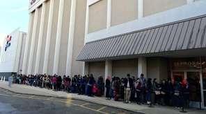 Thanksgiving Day shoppers line up outside the JCPenney