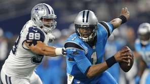 Carolina Panthers quarterback Cam Newton (1) is unable