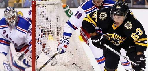 Brad Marchand of the Boston Bruins looks for