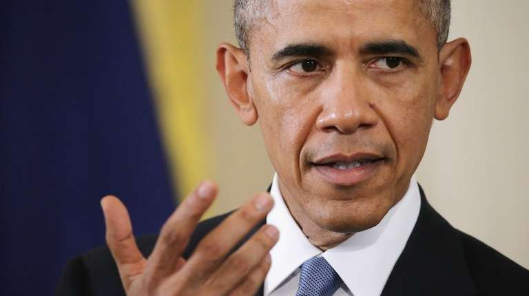 President Barack Obama answers reporters' questions during a