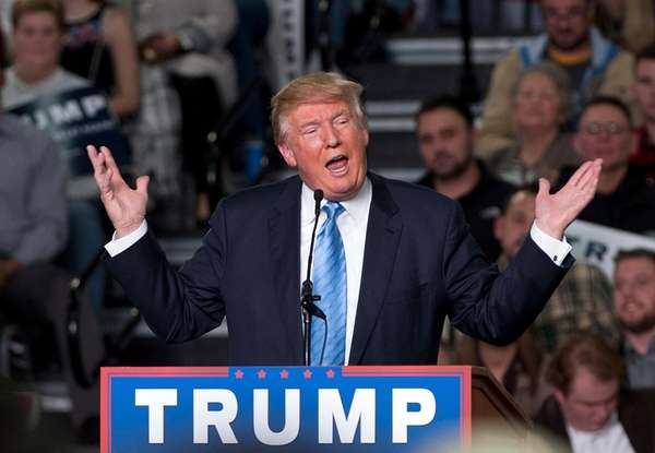 Republican presidential candidate Donald Trump addresses supporters during