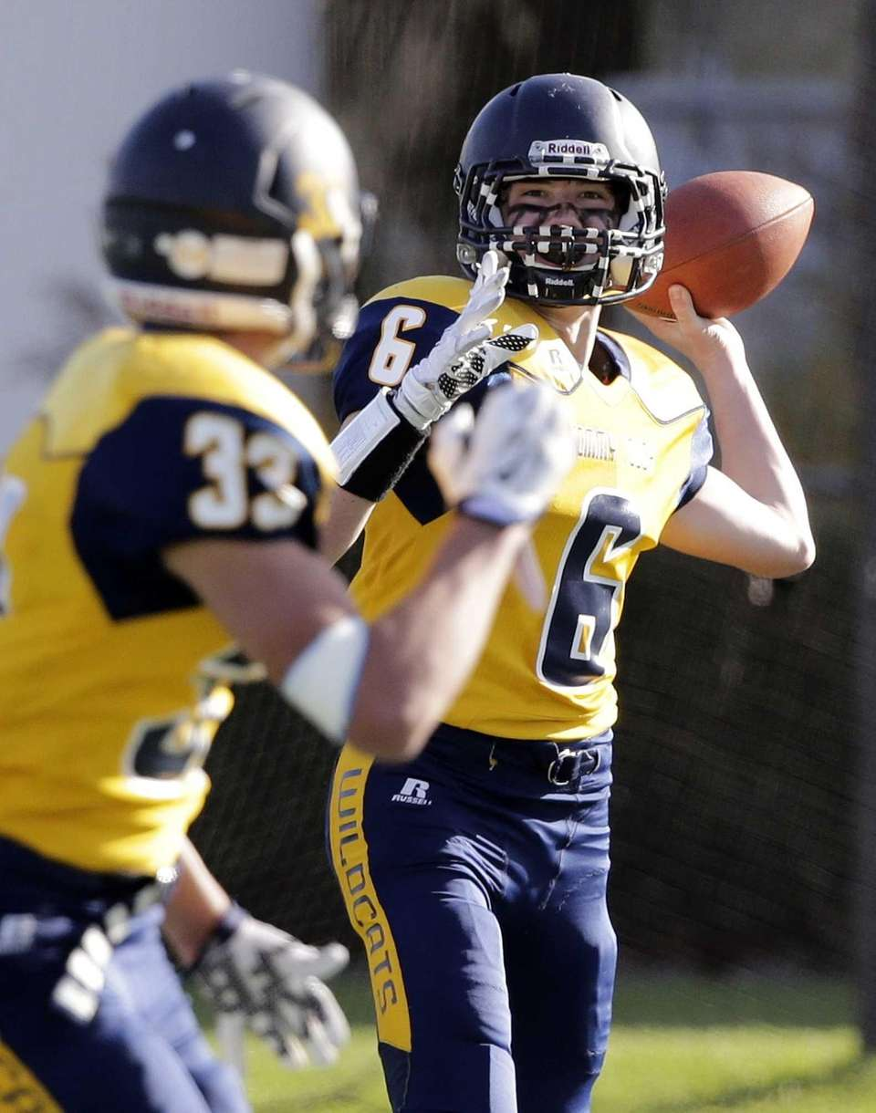 Shoreham-Wading River quarterback Jason Curran (6) looks to