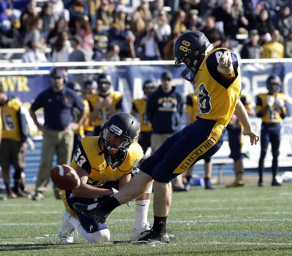 Shoreham-Wading River kicker Daniel Mahoney (88) with another