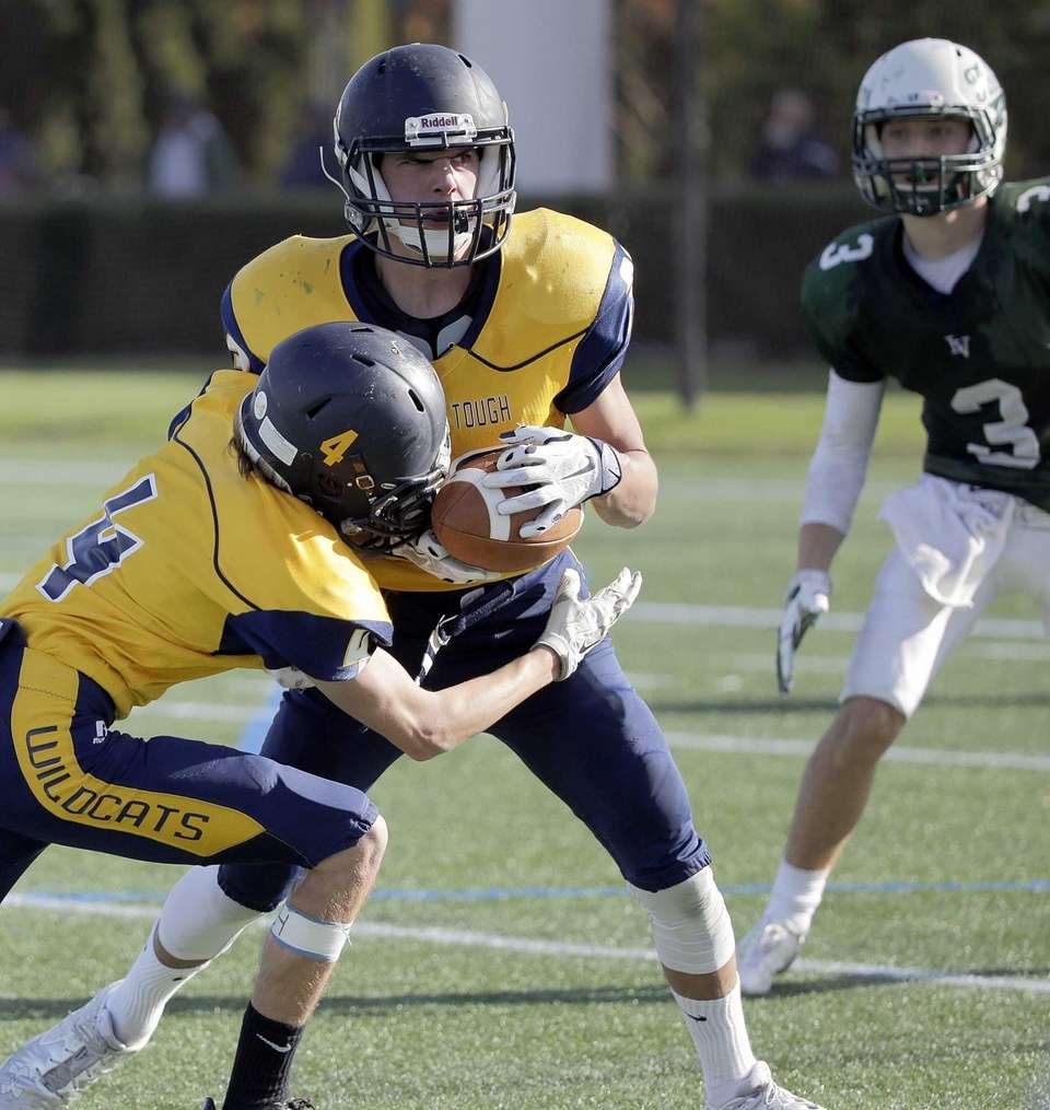 Shoreham-Wading River defensive back Kyle Fehmel (4) tips