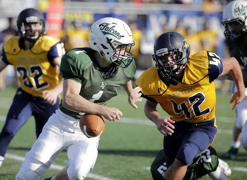 Locust Valley runningback John Pendraghelu (1) loses the