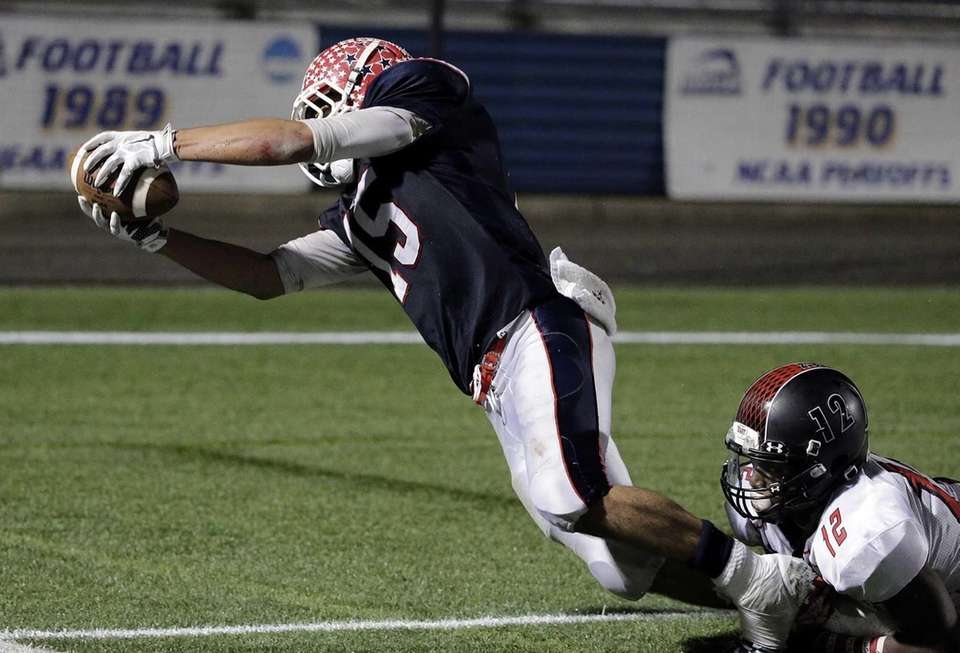MacArthur wide receiver Jared Wolfe (15) dives into