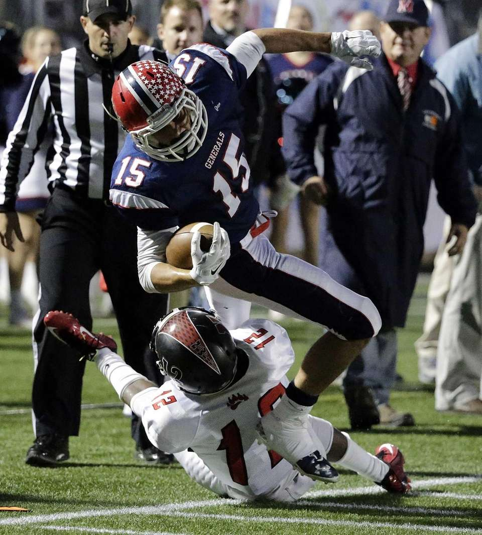 MacArthur wide receiver Jared Wolfe (15) dives for
