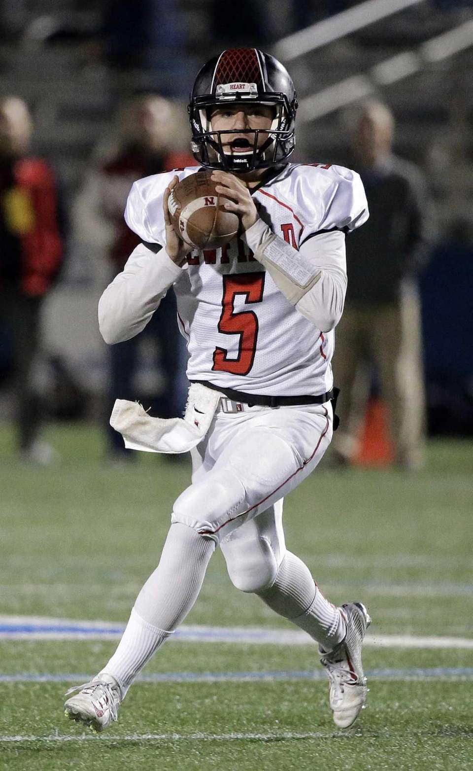 Newfield quarterback Ryan Klemm (5) rolls to the