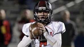 Newfield quarterback Ryan Klemm (5) rolls to the