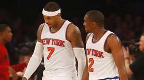 Carmelo Anthony #7 and Langston Galloway #2 of